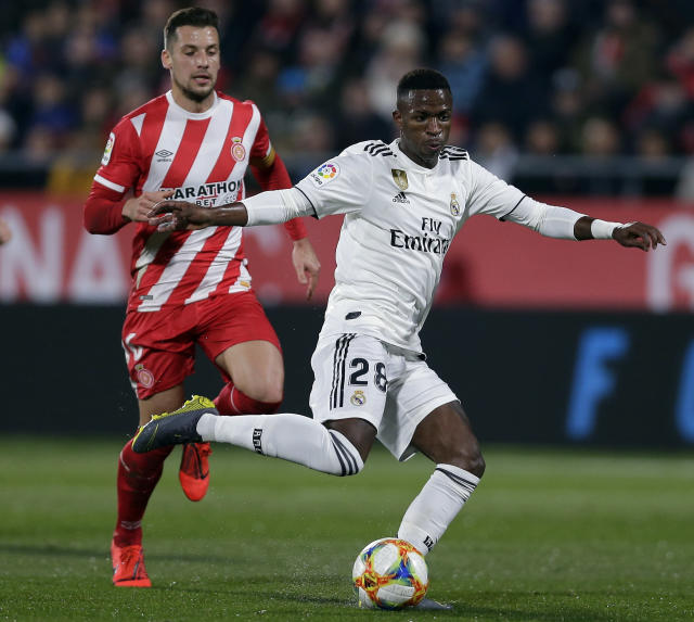 Real Madrid's Vinicius, right, duels for the ball with Girona's Borja Garcia during a Spanish Copa del Rey soccer match between Girona and Real Madrid at the Montilivi stadium in Girona, Spain, Thursday, Jan. 31, 2019. (AP Photo/Manu Fernandez)