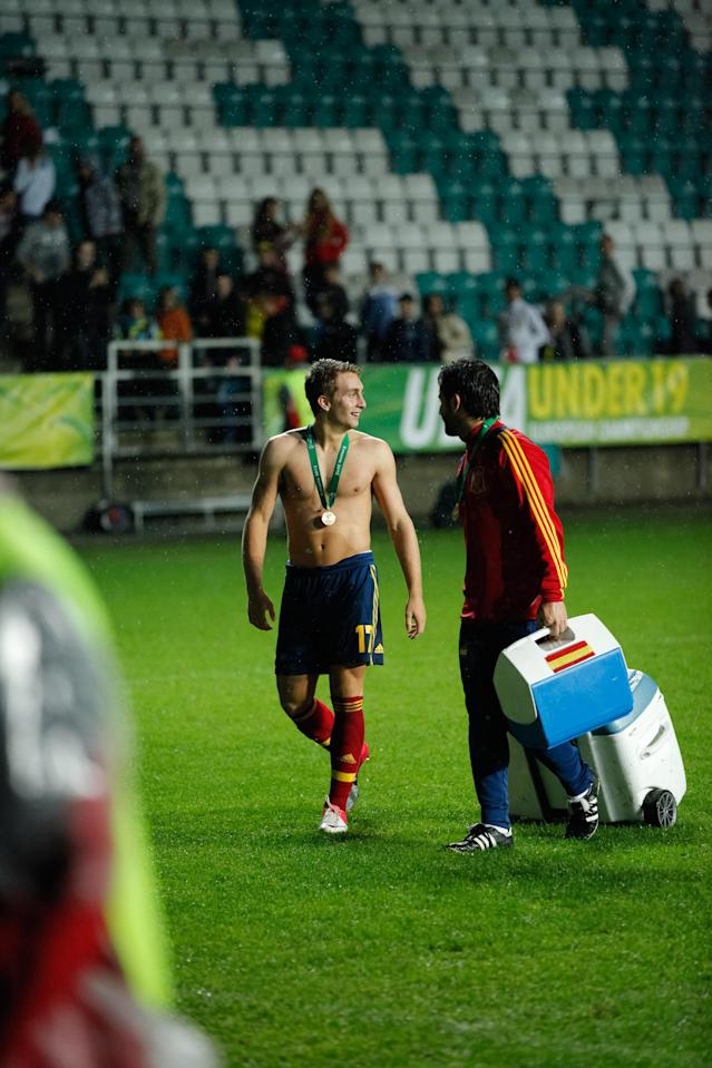 Spanish player Gerard Deulofeu (L) talks with a teammate after their team's 1-0 victory against Greece in the UEFA European Under-19 football championships final match between Spain and Greece, in Tallin, on July 15, 2012. AFP PHOTO / JAREK JOEPERAJarek Joepera/AFP/GettyImages