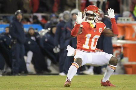 FILE PHOTO: Jan 20, 2019; Kansas City, MO, USA; Kansas City Chiefs wide receiver Tyreek Hill (10) reacts during the first half of the AFC Championship game against the New England Patriots at Arrowhead Stadium. Mandatory Credit: Kirby Lee-USA TODAY Sports