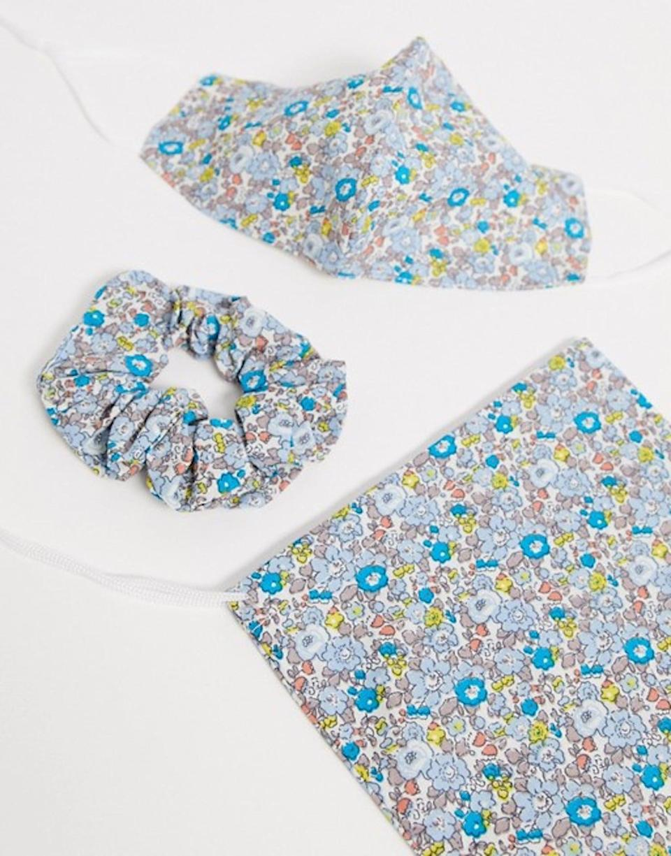 <p><span>ASOS DESIGN Blue Floral Face Covering With Pouch &amp; Scrunchie</span> ($19)</p>