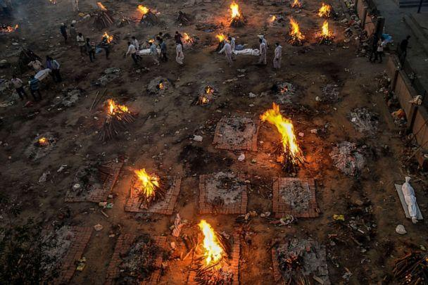 PHOTO: New bodies arrive at a mass cremation site in Delhi, April 23, 2021. (Atul Loke/The New York Times/Redux Pictures)