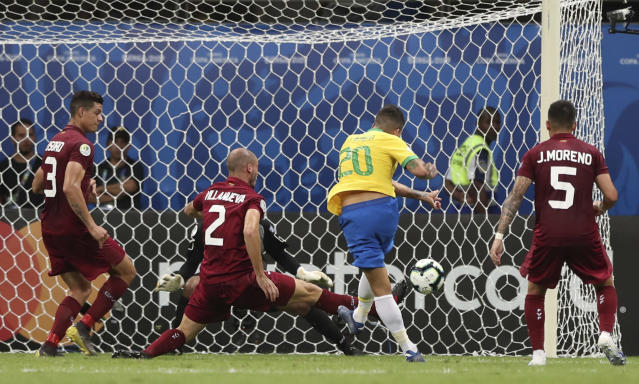 Brazil's Roberto Firmino shoots to score a goal that was disallowed by the referee during a Copa America Group A soccer match against Venezuela at the Arena Fonte Nova in Salvador, Brazil, Tuesday, June 18, 2019. (AP Photo/Ricardo Mazalan)