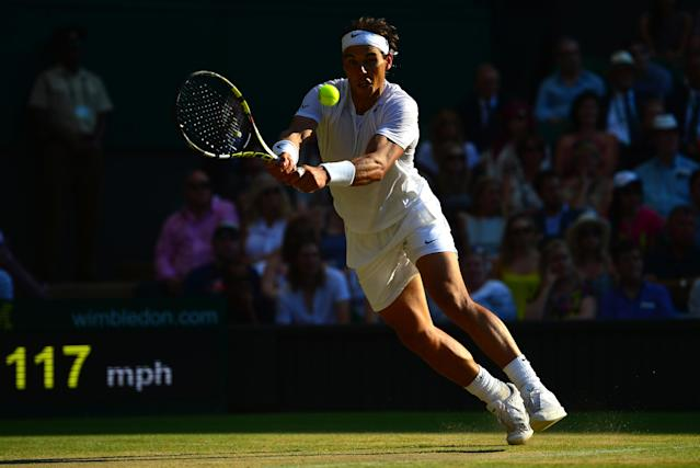 Spain's Rafael Nadal returns to Australia's Nick Kyrgios during their men's singles fourth round match on day eight of the 2014 Wimbledon Championships on July 1, 2014 (AFP Photo/Carl Court)