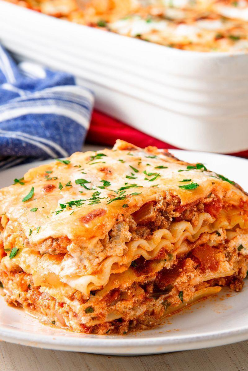 """<p>We took a couple of shortcuts for this recipe by using shop-bought <a href=""""https://www.delish.com/uk/cooking/recipes/a35595629/baked-cream-cheese-pasta-recipe/"""" rel=""""nofollow noopener"""" target=""""_blank"""" data-ylk=""""slk:pasta sauce"""" class=""""link rapid-noclick-resp"""">pasta sauce</a> and boxed pasta sheets. It saves a ton of time without sacrificing any flavour. We think it's absolutely perfect as-is, but also understand some people are looking to make sauce from scratch.</p><p>Get the <a href=""""https://edit-delish.hearstapps.com/uk/content/edit/5db7ab5a-2c7d-4497-8b51-8896125e1642"""" rel=""""nofollow noopener"""" target=""""_blank"""" data-ylk=""""slk:Classic Lasagne"""" class=""""link rapid-noclick-resp"""">Classic Lasagne</a> recipe.</p>"""