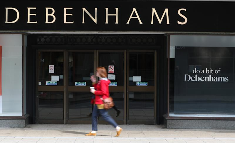 A person walks past a Debenhams department store in Southsea, Hampshire, which has been named as one of 22 stores to be closed, putting 1,200 jobs at risk across the department store chain.