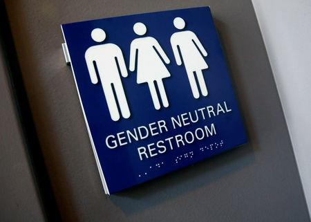 FILE PHOTO: A Gender Neutral Restroom sign is seen placed outside a restroom for the 15th Annual Philadelphia Trans-Health Conference in Philadelphia