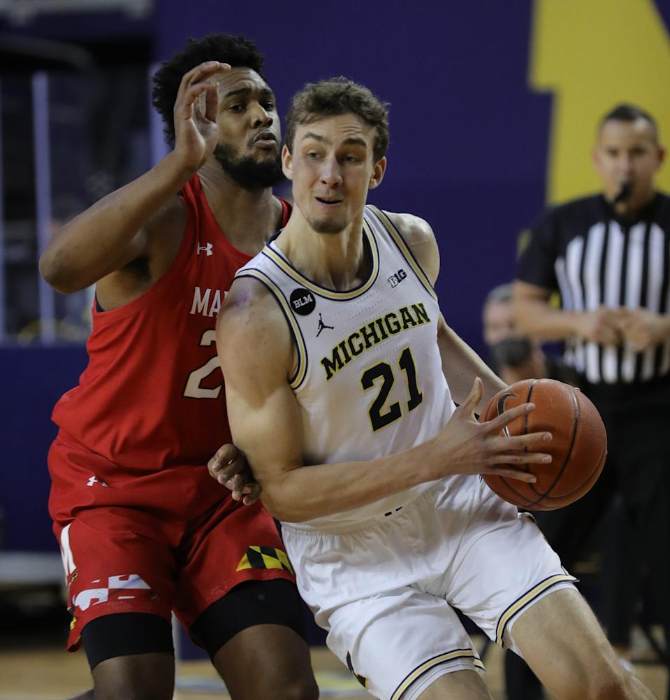 Michigan Wolverines guard Franz Wagner (21) drives against Maryland Terrapins forward Donta Scott (24) during first half action Tuesday, Jan. 19, 2021, in Ann Arbor.