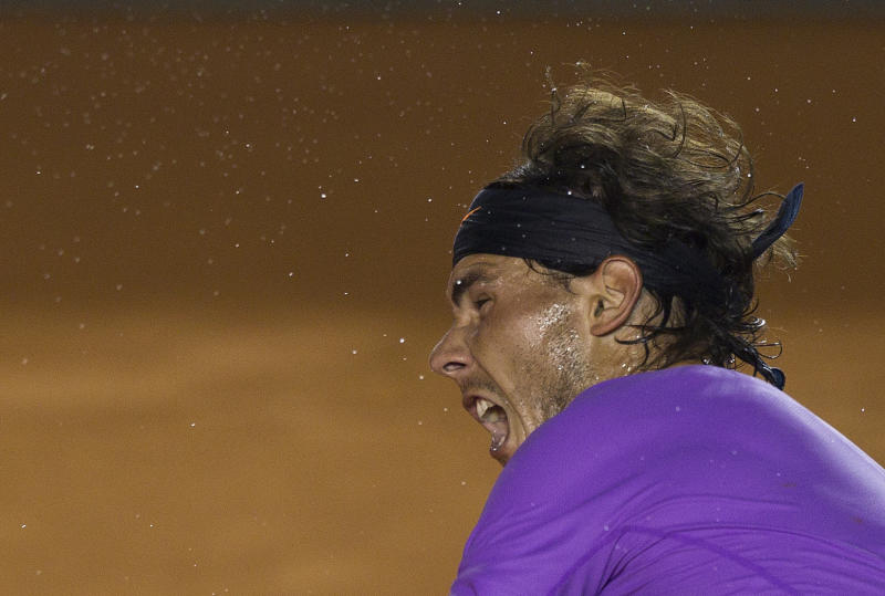 Spain´s Rafael Nadal serves to Spain´s David Ferrer es during the final round match at the Mexico Open in Acapulco, Mexico, Saturday, March 2, 2013. (AP Photo/Christian Palma)
