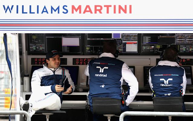 <span>Felipe Massa relaxes during the cancelled practice session at the chines Grand Prix</span> <span>Credit: Getty Images </span>
