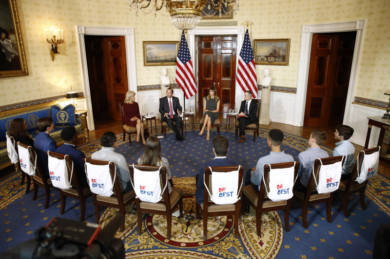 First lady Melania Trump, second from right, attends a listening session with teenagers about their experiences with electronic cigarettes and vaping in the Blue Room of the White House, Wednesday, Oct. 9, 2019, in Washington. Seated with Trump are counselor to the President Kellyanne Conway, from left, Health and Human Services Secretary Alex Azar and Eric Asche with the Truth Initiative. (AP Photo/Patrick Semansky)