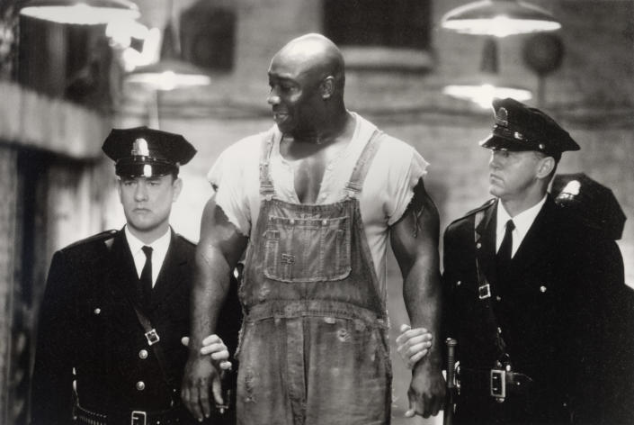"""This undated image provided by Warner Bros. shows Tom Hanks, left, Michael Clarke Duncan, center, and David Morse in """"The Green Mile."""" Duncan has died at the age of 54 on Monday, Sept. 3, 2012 in a Los Angeles hospital after nearly two months of treatment following a July 13, 2012 heart attack, his fiancee, the Rev. Omarosa Manigault, said. (AP Photo/Warner Bros., Ralph Nelson)"""