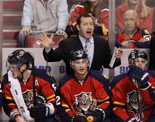 Florida Panthers head coach Kevin Dineen, rear, reacts after a call during the second period of an NHL hockey game against the New Jersey Devils, Tuesday, Dec. 13, 2011, in Sunrise, Fla. (AP Photo/Wilfredo Lee)