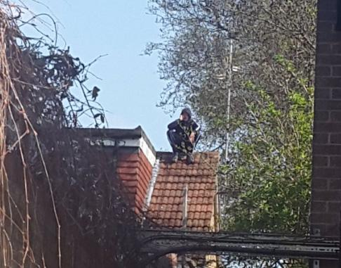 Caught: the moped rider was found on a roof with his hood pulled over: @MPSRTPC