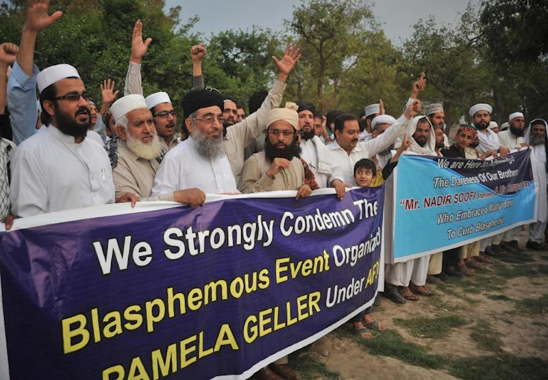 Pakistani residents shout slogans as they march behind a banner during a protest in Peshawar on May 5, 2015, against the anti-Muslim cartoon exhibition in Garland, Texas (AFP Photo/Hasham Ahmed)