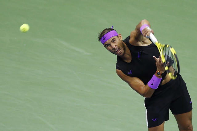 Rafael Nadal, of Spain, serves to Marin Cilic, of Croatia, during the fourth round of the U.S. Open tennis tournament Monday, Sept. 2, 2019, in New York. (AP Photo/Jason DeCrow)