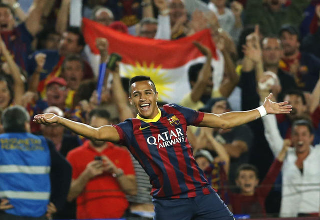 Barcelona's Alexis Sanchez celebrates after scoring during a Spanish La Liga soccer match between Barcelona F.C. and Real Madrid at the Camp Nou stadium in Barcelona, Spain, Saturday, Oct. 26, 2013. (AP Photo/Emilio Morenatti)