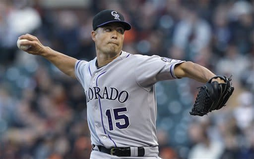 Colorado Rockies' Jeremy Guthrie pitches to the San Francisco Giants during the first inning of a baseball game in San Francisco, Tuesday, May 15, 2012. (AP Photo/Jeff Chiu)
