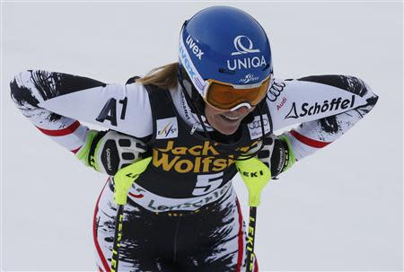 Marlies Schild of Austria reacts in the finish area during the first run of the women's slalom at the FIS Alpine Skiing World Cup Finals in Lenzerheide March 15, 2014. REUTERS/Leonhard Foeger