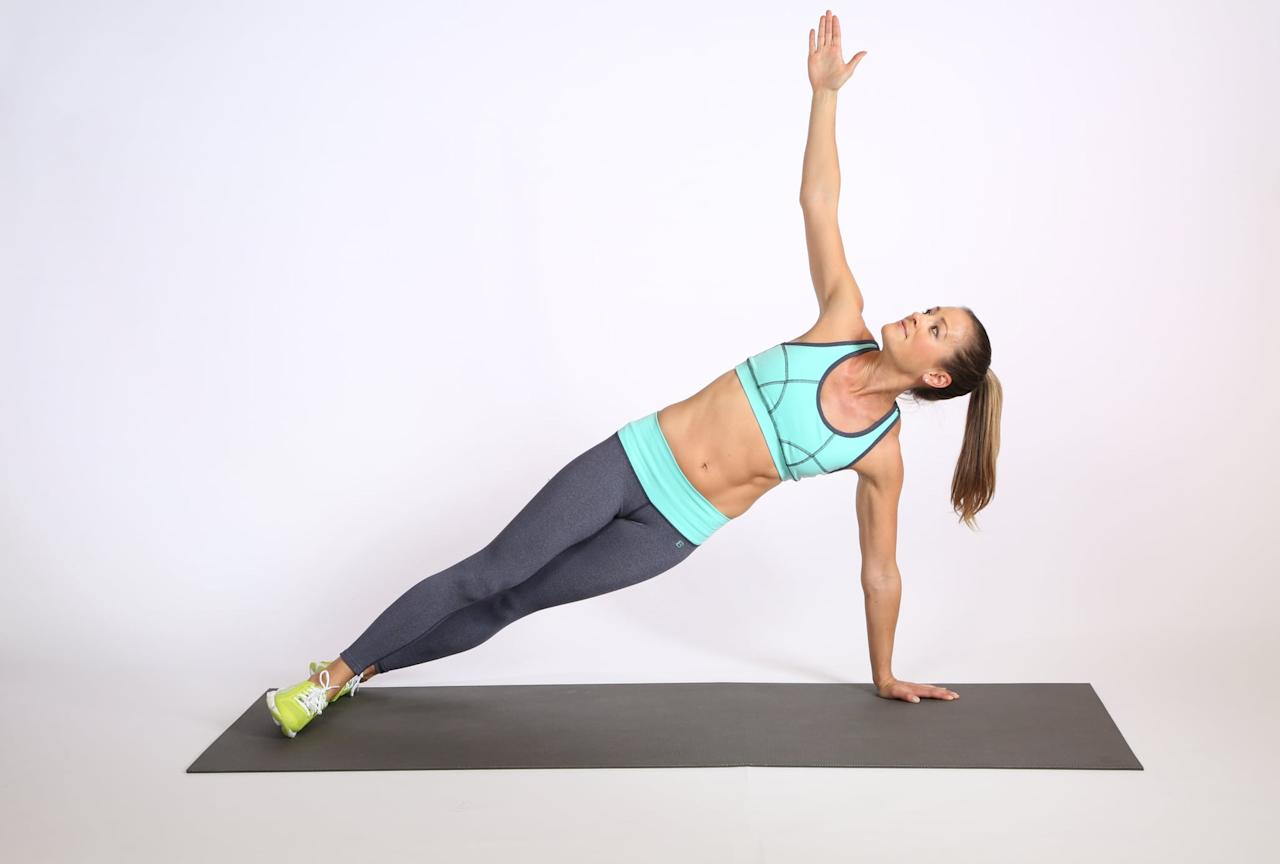 <ul> <li>Come into a plank position (the top of a push-up), and roll to your left side, allowing your feet to roll, too, so you're balancing on the outside of your left foot and the inside of your right. To advance this move, stack your right foot on top of your left. </li> <li>Reach your right arm toward the ceiling and lift your waist away from the floor to make your obliques fire away. Press your left inner thigh up into your right inner thigh; this helps stabilize you even more.</li> <li>To take pressure off of your wrist, press your left fingertips into the floor.</li> <li>Hold for 30 seconds. </li> </ul>