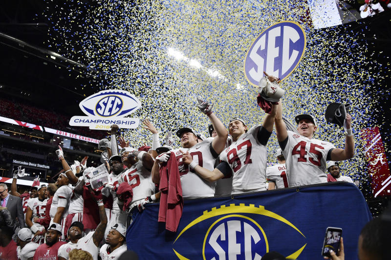 Alabama players celebrate after the Southeastern Conference championship NCAA college football game against Georgia, Saturday, Dec. 1, 2018, in Atlanta. Alabama won 35-28. (AP Photo/John Amis)