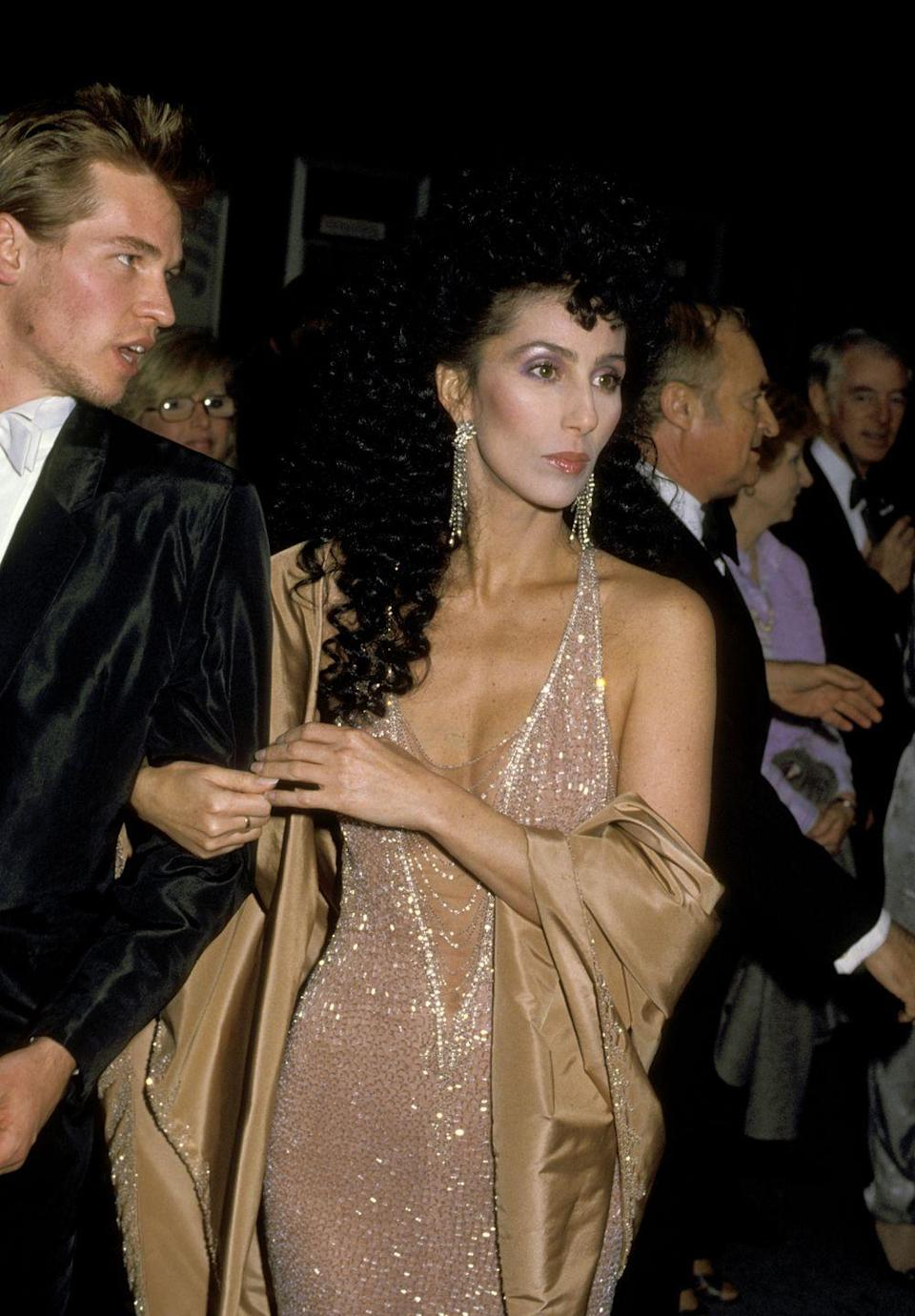 <p>With Val Kilmer in a nude sequin gown at the Oscars.</p>