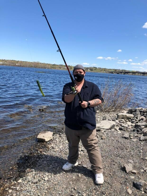 Shelter outreach worker Dara Rector is an avid bass fisherman and eager to take more fishing trips with shelter guests this season. (Jennifer Sweet/CBC - image credit)