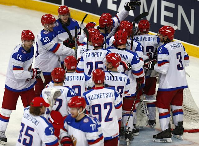 Russia's players celebrate their victory during a semifinal match between Russia and Sweden at the Ice Hockey World Championship in Minsk, Belarus, Saturday, May 24, 2014. (AP Photo/Sergei Grits)