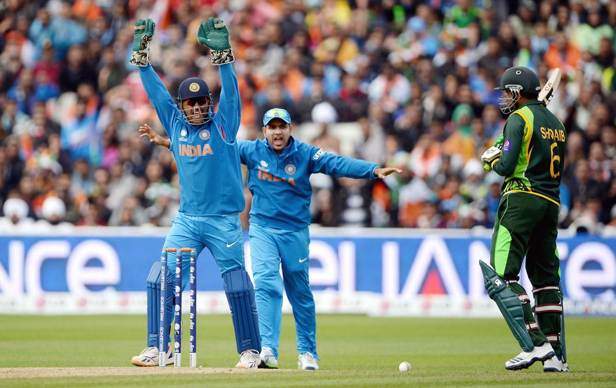 India captain MS Dhoni celebrates the dismissal of Shoaib Malik of Pakistan during the ICC Champions Trophy match between India and Pakiatan at Edgbaston on June 15, 2013 in Birmingham, England.  (Photo by Gareth Copley/Getty Images)