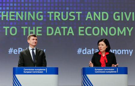 Andrus Ansip, Commission vice-president for the digital single market (L) and EU Justice Commissioner Vera Jourova hold a joint news conference on the European Commission proposal to extend some rules that now only apply to telecom operators to web companies offering calls and messages using the internet, at the EC headquarters in Brussels, Belgium January 10, 2017. REUTERS/Yves Herman