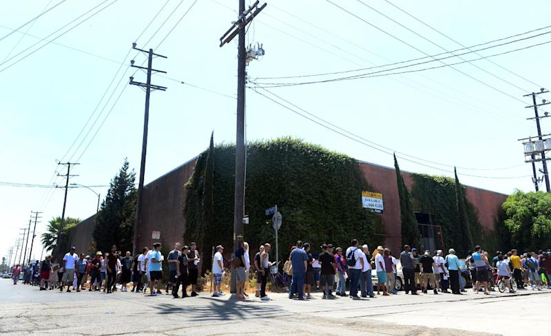 Card-carrying patients wait in line to enter Los Angeles, California's first-ever cannabis farmer's market at the West Coast Collective medical marijuana dispensary on July 4, 2014 (AFP Photo/Frederic J. Brown)