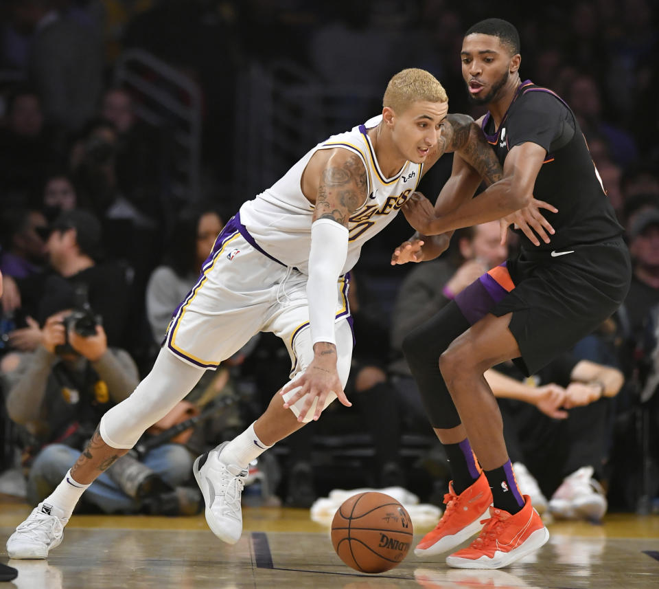 LOS ANGELES, CA - JANUARY 01: Kyle Kuzma #0 of the Los Angeles Lakers Mikal Bridges #25 of the Phoenix Suns at Staples Center on January 1, 2020 in Los Angeles, California. NOTE TO USER: User expressly acknowledges and agrees that, by downloading and/or using this photograph, user is consenting to the terms and conditions of the Getty Images License Agreement. Lakers won 117 to 107. (Photo by John McCoy/Getty Images)
