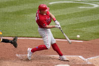 Philadelphia Phillies' J.T. Realmuto hits a double off Pittsburgh Pirates starting pitcher Mitch Keller, driving in a run, during the fifth inning of a baseball game in Pittsburgh, Sunday, Aug. 1, 2021. (AP Photo/Gene J. Puskar)