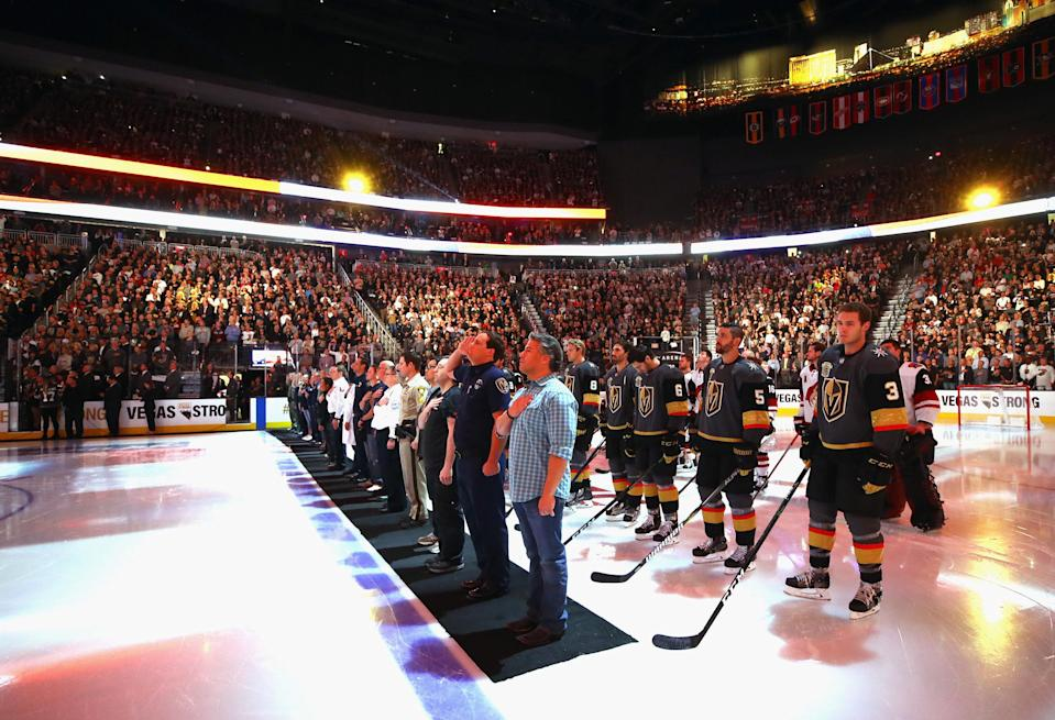 <p>Members of the medical and law enforcement communities accompany the players onto the ice during player introductions. (Bruce Bennett/Getty Images) </p>