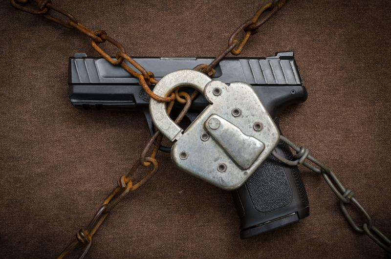 Pistol chained down by padlock