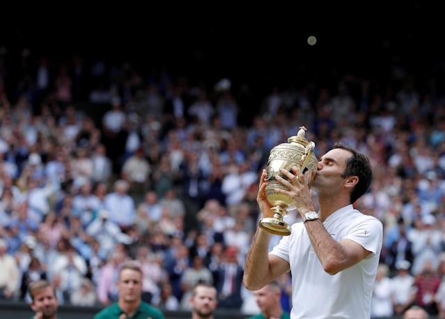 "Switzerland's Roger Federer kisses the trophy after winning his Men's Singles Final match against Croatia's Marin Cilic in the Wimbledon Tennis Championships in London, Britain, July 16, 2017. REUTERS/Andrew Couldridge/File Photo SEARCH ""POY SPORT"" FOR THIS STORY. SEARCH ""REUTERS POY"" FOR ALL BEST OF 2017 PACKAGES. TPX IMAGES OF THE DAY"