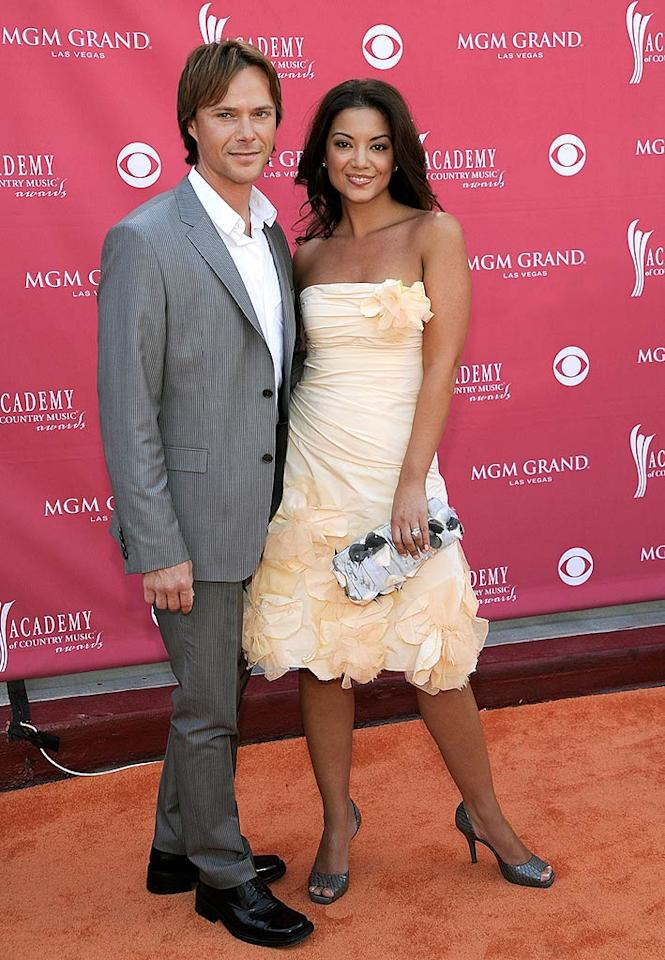 """Singer Bryan White was casual in a gray suit and white button down, while his wife Erika went with a peachy number that would be perfect for prom. Charley Gallay/<a href=""""http://www.gettyimages.com/"""" target=""""new"""">GettyImages.com</a> - May 18, 2008"""