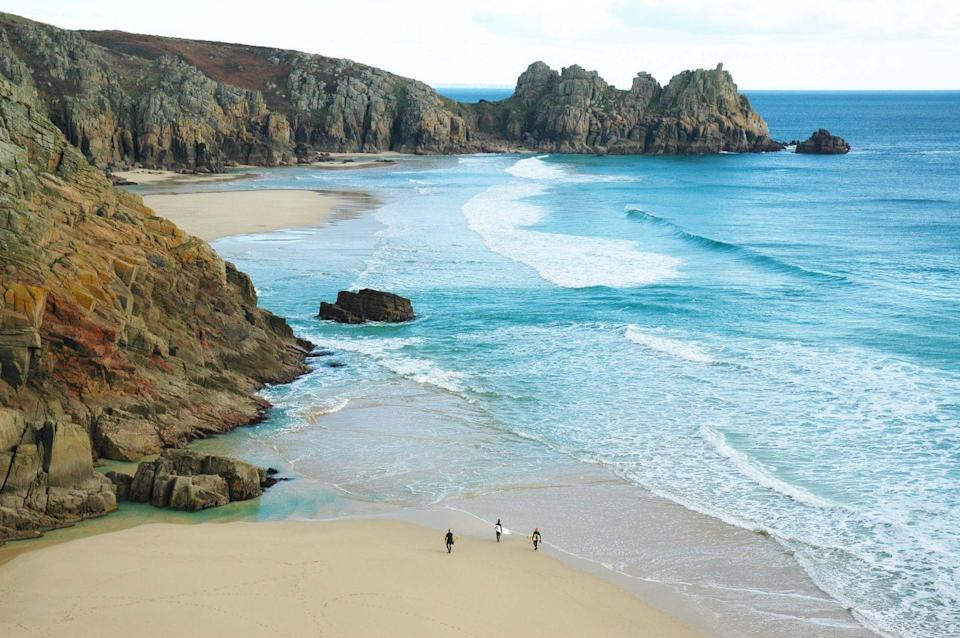 """<p>There's a reason Porthcurno's curve of white sandy beach, contrasted with tropical blue waters and moss-covered granite cliffs, often features on the cover of Cornish holiday brochures. The scene is as alluring as any tropical island getaway. If you go for a splash, have a care at high tide as there is a steep shelf that can be dangerous for swimmers.</p><p><strong>Don't Miss:</strong> Catch a performance at the open-air <u><a href=""""https://www.minack.com/minack-theatre"""" rel=""""nofollow noopener"""" target=""""_blank"""" data-ylk=""""slk:Minack Theatre"""" class=""""link rapid-noclick-resp"""">Minack Theatre</a></u>, perched on the rugged cliffs and offering unrivalled sunset views.</p>"""