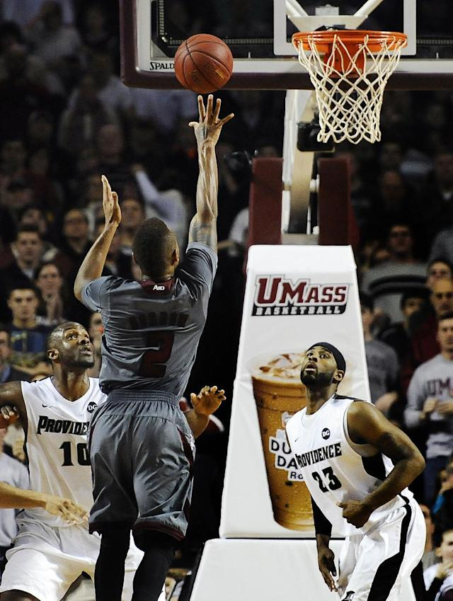 CORRECTS MASSACHUSETT'S PLAYER TO DERRICK GORDON FROM JABARIE HINDS - Massachusetts' Derrick Gordon hits the go-ahead basket during overtime of an NCAA college basketball game against Providence, Saturday, Dec. 28, 2013, in Amherst, Mass. UMass won 69-67. (AP Photo/Jessica Hill)
