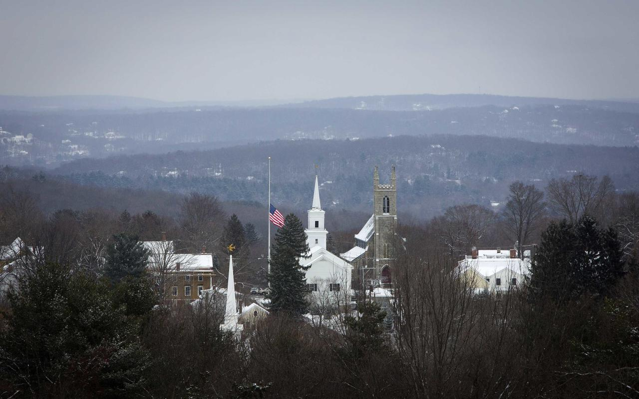The town flag flies at half staff in Newtown, Connecticut December 14, 2013. Today marks the one year anniversary of the shooting rampage at Sandy Hook Elementary School, where 20 children and six adults were killed by gunman Adam Lanza. REUTERS/Carlo Allegri (UNITED STATES - Tags: CRIME LAW)