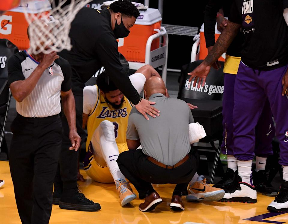 Los Angeles, CA - June 03:  Anthony Davis #3 of the Los Angeles Lakers sits on the court after a injury against the Phoenix Suns in the first half of game six of the Western Conference First Round NBA Playoff basketball game at the Staples Center in Los Angeles on Thursday, June 3, 2021. (Photo by Keith Birmingham/MediaNews Group/Pasadena Star-News via Getty Images)