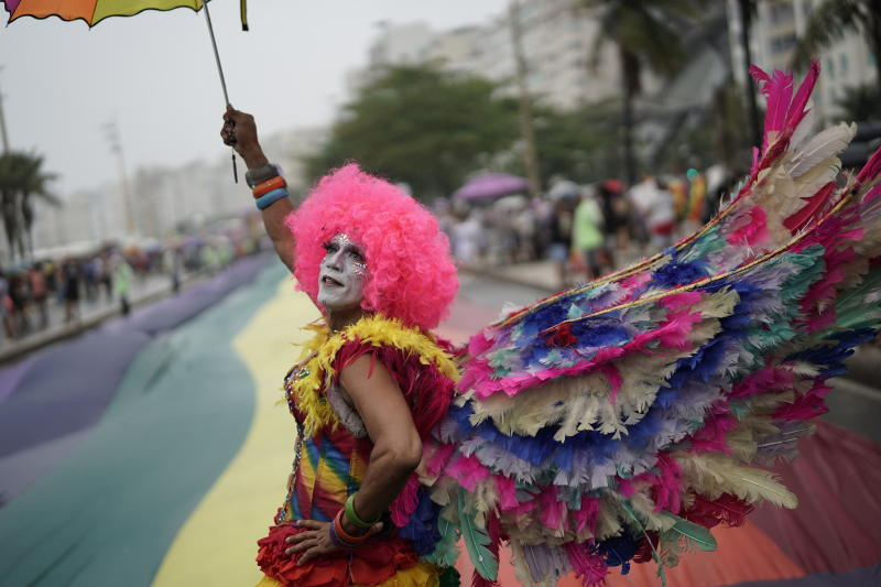 A person in costume strikes a pose during the annual gay pride parade along Copacabana beach in Rio de Janeiro, Brazil, Sunday, Sept. 22, 2019. (AP Photo/Leo Correa)
