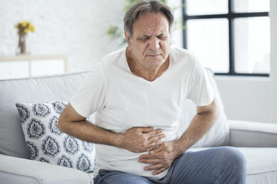 Old man with stomachache
