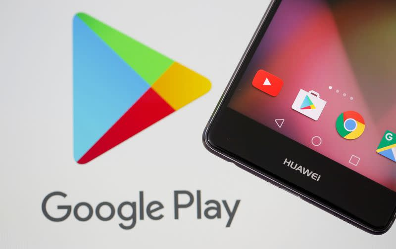 FILE PHOTO: A Huawei smartphone is seen in front of displayed Google Play logo in this illustration picture