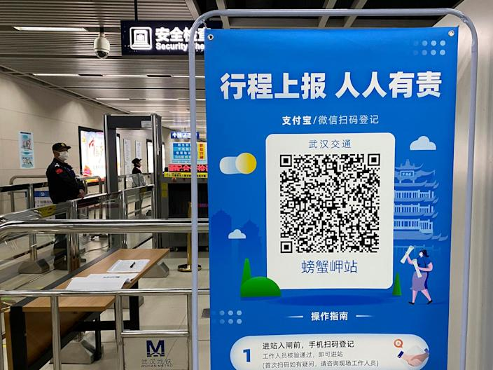 A QR code is set up for passengers to check their green pass status at a subway station in Wuhan on April 01, 2020.