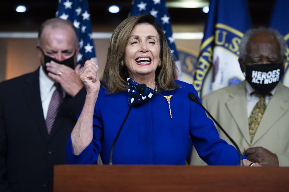 UNITED STATES - JULY 24: Speaker of the House Nancy Pelosi, D-Calif., tells a story about trying to call Rob Reiner, during a news conference to call for the extension of the federal unemployment insurance in the Capitol Visitor Center to on Friday, July 24, 2020. Reps. Danny Davis, D-Ill., right, and Dan Kildee, D-Mich., also appear. Pelosi dialed the wrong number when trying to call Reiner to offer condolences for his late father, Carl. (Photo By Tom Williams/CQ-Roll Call, Inc via Getty Images)