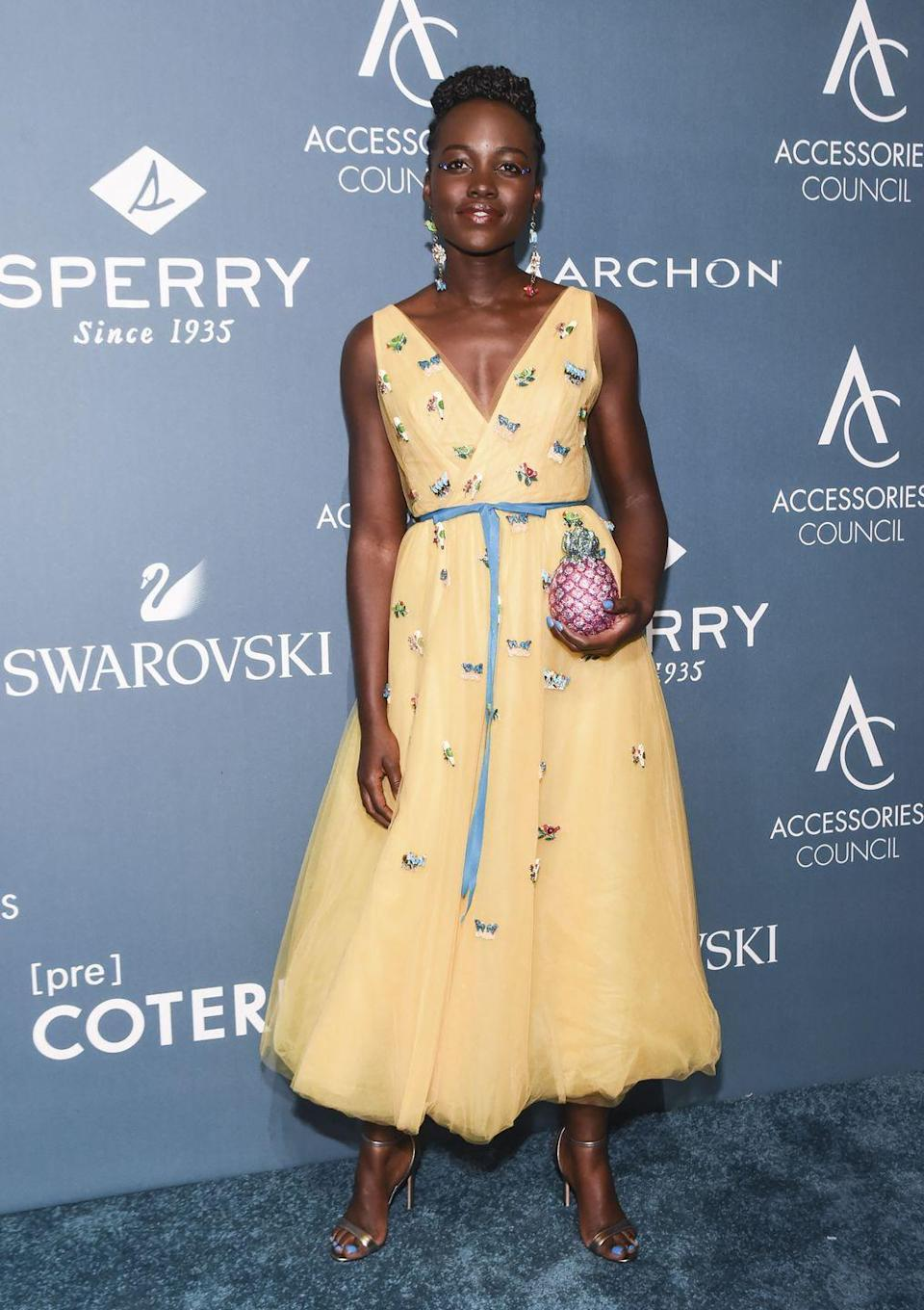 <p>The actress wore a Carolina Herrera dress with a Judith Leiber pineapple clutch to the Accessories Council ACE Awards in New York.</p>