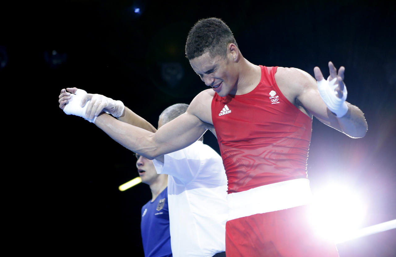 Britain's Anthony Ogogo reacts as he is declared the winner over Germany's Stefan Hartel (L) after their quarterfinal Men's Middle (75kg) boxing match at the London Olympic Games August 6, 2012.     REUTERS/Murad Sezer (BRITAIN  - Tags: SPORT BOXING OLYMPICS)