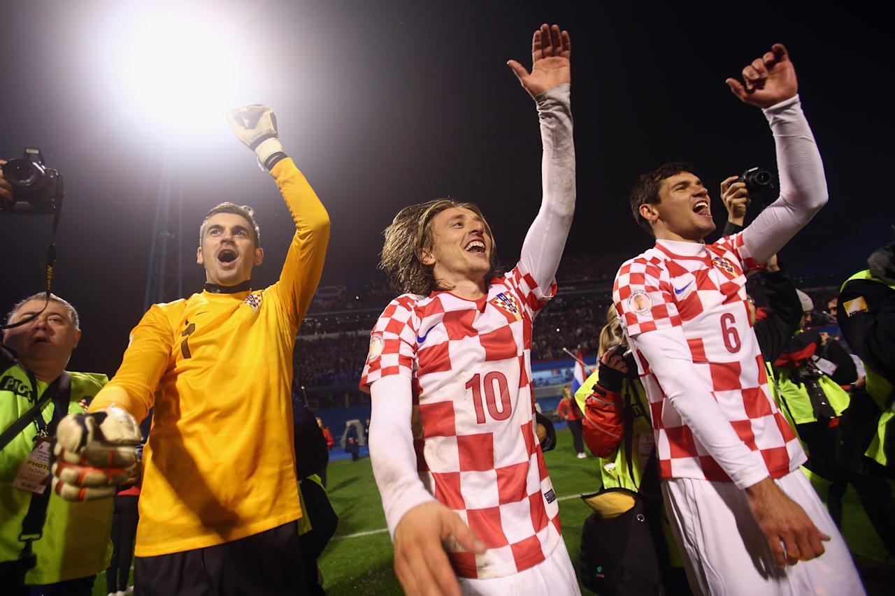 ZAGREB, CROATIA - NOVEMBER 19: Stipe Pletikosa, Luka Modric and Dejan Lovren (L-R) of Croatia celebrate after the FIFA 2014 World Cup Qualifier play-off second leg match between Croatia and Iceland at Maksimir Stadium on November 19, 2013 in Zagreb, Croatia. (Photo by Alex Grimm/Getty Images)