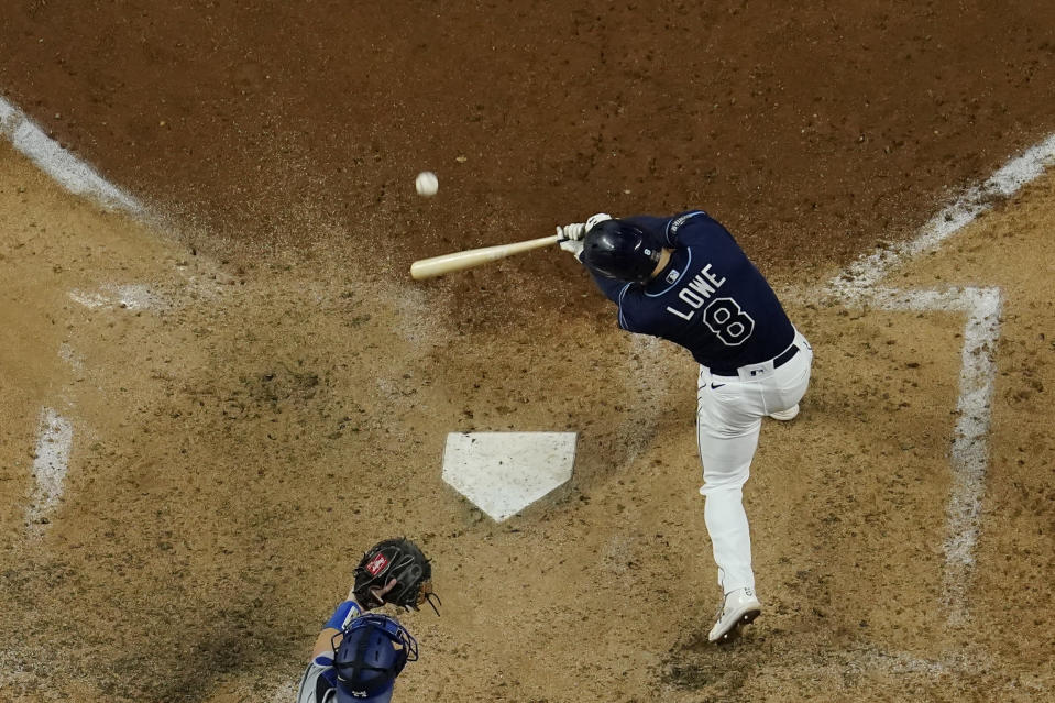 Tampa Bay Rays' Brandon Lowe hits a three-run home run against the Los Angeles Dodgers during the sixth inning in Game 4 of the baseball World Series Saturday, Oct. 24, 2020, in Arlington, Texas. (AP Photo/David J. Phillip)