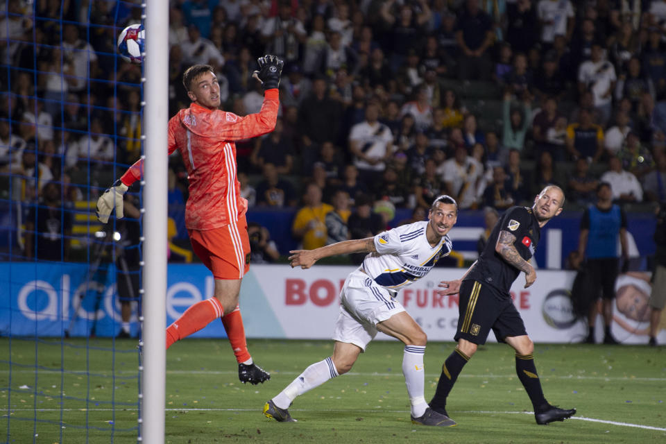 Jul 19, 2019; Carson, CA, USA; LA Galaxy forward Zlatan Ibrahimovic (9) heads the ball for a goal while Los Angeles FC defender Jordan Harvey (2) defends during the second half  at Dignity Health Sports Park. Mandatory Credit: Kelvin Kuo-USA TODAY Sports